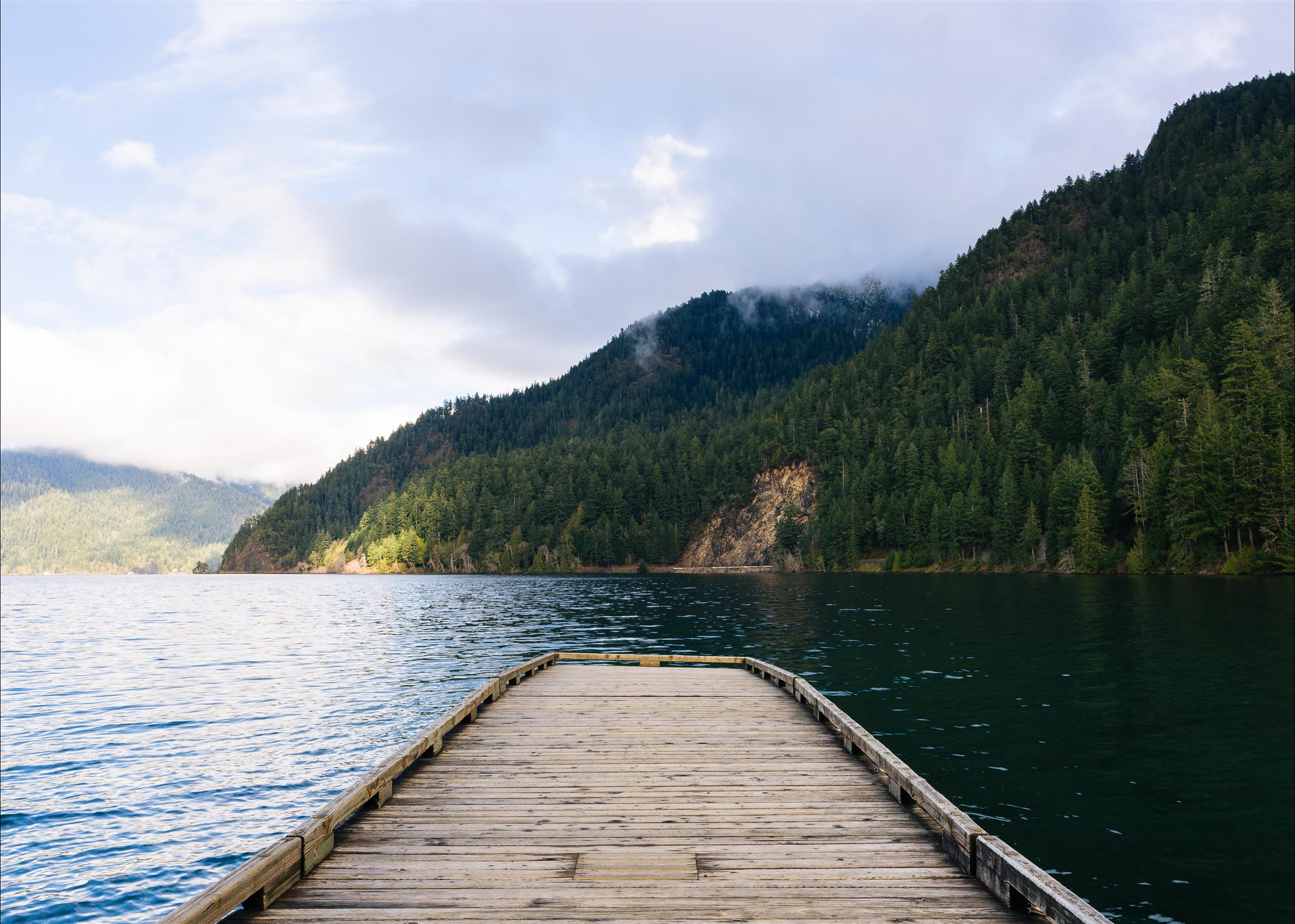 the docks with water and mountains with all the green trees